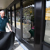 John Fanary, owner of Stagecoach Salon, lays a mat down in front of his business on Main Street. He was shut down due to the coronavirus.<br /> (Rick Barbero/The Register-Herald)