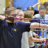 (Brad Davis/The Register-Herald) Shady's Spring Middle School 6th grader Bryce Collins aims and shoots as he and others from area schools compete in the Shady Spring Invitational Archery Tournament Saturday afternoon at Shady Middle.