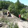 Construction crew for Aspen working on the road that collapsed at The Raleigh Center in Daniels back in February. Depending on the weather the road should be completed by July 1.<br /> (Rick Barbero/The Register-Herald)