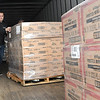 Pastor John Jordan, of Calvary Assembly of God Church on 319 Sunset Drive in Beckley, help unload food from the Convoy of Hope truck that arrive Thursday morning delivering 35,000 pounds of groceries that will be handed out beginning10 am Saturday in the church parking lot.<br /> (Rick Barbero/The Register-Herald)