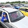 Frank Workman listens to speeches during Greenbrier West High School graduation ceremony Friday evening  held at the State Fair of West Virginia's free parking lot in Fairlea. <br /> (Rick Barbero/The Register-Herald)