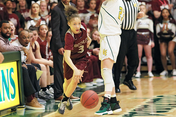 Woodrow Wilson's Keanti Thompson gets around Greenbrier East's Haley McClure during the Class AAA Region 3 Section 2 championship game at Greenbrier East Friday. (Jenny Harnish/The Register-Herald)