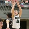 (Brad Davis/The Register-Herald) Wyoming East's McQuade Canada shoots from three-point range as Westside's Wesley Browning defends during the New River Community and Technical College Shootout Saturday at the Beckley-Raleigh County Convention Center.