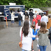 Customers line up at Philipo's Food Trailer in the Parking lot of United Way of Southern WV.  (Rick Barbero/The Register-Herald)