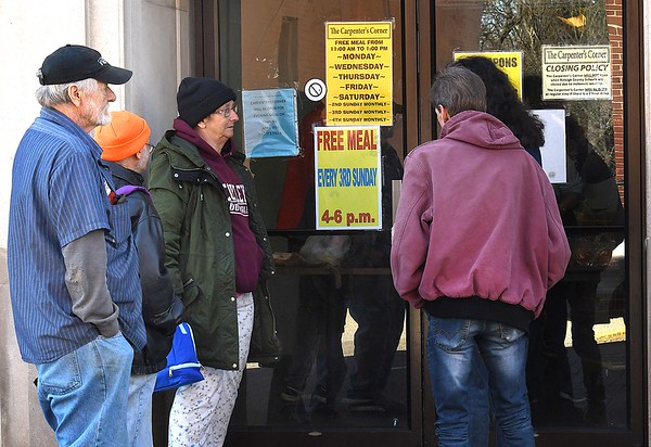 People waiting outside the entrance of Carpenters Corner on Prince Street in Beckley Thursday afternoon.