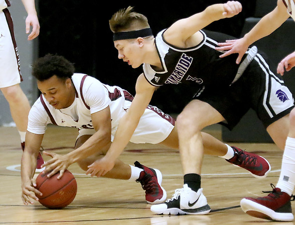 (Brad Davis/The Register-Herald) Woodrow Wilson's Richard Law dives for a loose ball with Riverside's Josh Arthur Wednesday night at the Beckley-Raleigh County Convention Center.