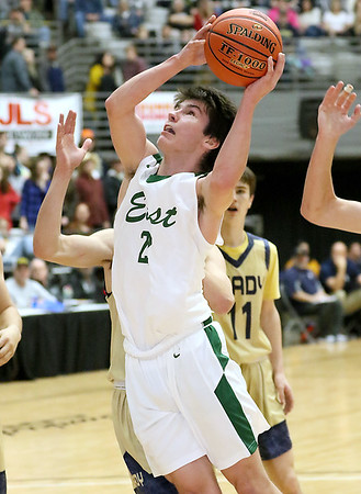 (Brad Davis/The Register-Herald) Greenbrier East's David Vance drives and scores against Shady Spring during the New River Community and Technical College Shootout Saturday at the Beckley-Raleigh County Convention Center.