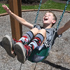 Maddox Morris, 10, enjoying his day in the playground during Camp Glade at The Resort at Glade Springs Monday afternoon.<br /> (Rick Barbero/The Register-Herald)