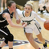 (Brad Davis/The Register-Herald) Wyoming East's Skylar Davidson hustles up the court as Westside's Makayla Morgan pressures during Friday action at the New River Community and Technical College Shootout at the Beckley-Raleigh County Convention Center.