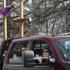 Truck carrying three crosses make their way down Harper Road in Beckley Sunday during the Calvary Assembly of God Easter parade Sunday afternoon. The Church also held service in their parking with the congregation listening from inside their vehicles due to the COVD-19 pandemic.  i<br /> (Rick Barbero/The Register-Herald)