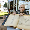 Jim Hall displays one of the many articles about Lake Stephens. Hall help establish the lake back in the late 50s and 60s and have saved many newspaper clippings and pictures of its early history.<br /> (Rick Barbero/The Register-Herald)