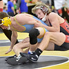 (Brad Davis/The Register-Herald) Independence's Judah Price takes on Oak Glen's Clayton Lamb in a 120-pound weight class matchup Friday afternoon at the 73rd Annual State Wrestling Tournament in Huntington. Indy's Price won the match.