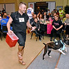 """(Brad Davis/The Register-Herald) Matt Hilliard and The Rock bring in the dollars during the Hunks in Heels """"Fur"""" Real fundraising event Friday night at the Beckley Moose Lodge."""