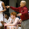(Brad Davis/The Register-Herald) Woodrow Wilson head coach Ron Kidd instructs his team against Greater Beckley Friday night at the Beckley-Raleigh County Convention Center.