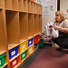 Kelly Ayers, pre-school teachers aid at Crescent Elementary School, cleans out lockers with materials belonging to students and placed them in seperate bags for students to pick up at a later date. Students normally help, but could not because of COVID-19.<br /> (Rick Barbero/The Register-Herald)