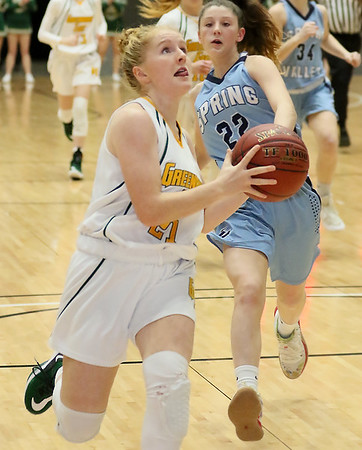 (Brad Davis/The Register-Herald) Greenbrier East's Kate Perkins drives and scores as Spring Valley's Hallie Bailey defends during Big Atlantic Classic action Thursday night at the Beckley-Raleigh County Convention Center.