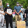 """Protest against racism and police brutality, titled """"In Solidarity, a Peaceful Protest,"""" was held Thursday evening on Washington Street in Lewisburg.<br /> (Rick Barbero/The Register-Herald)"""