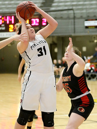 (Brad Davis/The Register-Herald) PikeView's Shiloh Bailey drives to the basket as University's Mallory Napolillo defends during Big Atlantic Classic action Thursday night at the Beckley-Raleigh County Convention Center.