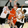 (Brad Davis/The Register-Herald) Summers County's Levi Jones drives and scores as Richwood's Dale Boone, left, and Jordan Hobart defend during Big Atlantic Classic action Wednesday night at the Beckley-Raleigh County Convention Center.