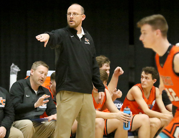 (Brad Davis/The Register-Herald) Summers County boys head coach Robert Bowling instructs his team against Richwood during Big Atlantic Classic action Wednesday night at the Beckley-Raleigh County Convention Center.