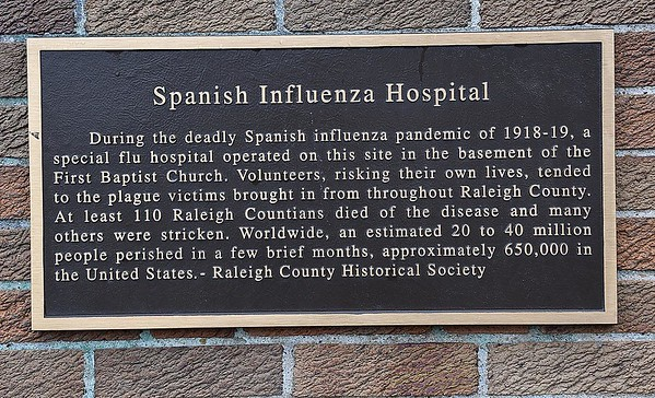 Sign on the First Baptist Church on Neville Street in Beckley. about the deadly Spanish influenza pandemic of 1918-19, a special flu hospital operated in the basement of the church.<br /> (Rick Barbero/The Register-Herald)