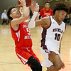 (Brad Davis/The Register-Herald) Greater Beckley's Kaden Smallwood drives to the basket as Woodrow Wilson's Bryant Jones defends Friday night at the Beckley-Raleigh County Convention Center.