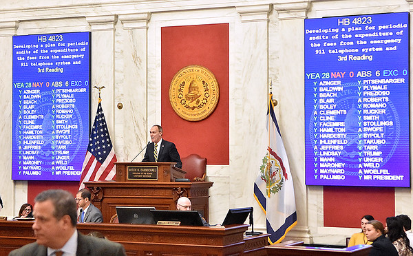 (Brad Davis/The Register-Herald) Votes roll in on another bill during a night session in the Senate during the final day of the state's regular legislative session Saturday in Charleston.