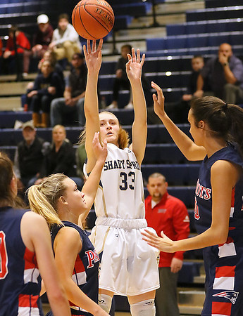 (Brad Davis/The Register-Herald) Shady Spring's Kierra Richmond shoots from three-point range as Independence's Bella Acord, right, and Makenzie Holley defend Thursday night in Shady Spring.