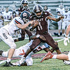 Woodrow Wilson's Nathaniel Grayton picks up yards as Parkersburg South's Aaron Davis and Devin Gaines make the stop during Friday evening action in Beckley. Photo by F. Brian Ferguson