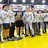 (Brad Davis/The Register-Herald) Greenbrier West grapplers and coaches pose for photos after winning a second straight Class A State Championship Saturday night at the 73rd Annual State Wrestling Tournament in Huntington.