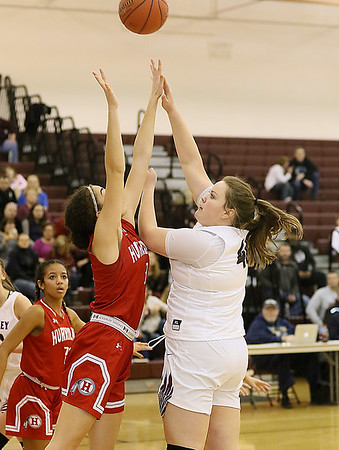 (Brad Davis/The Register-Herald) Woodrow Wilson's Taylor Gunter shoots from short range and scores as Hurricane's Nadia Legros defends Thursday night in Beckley.