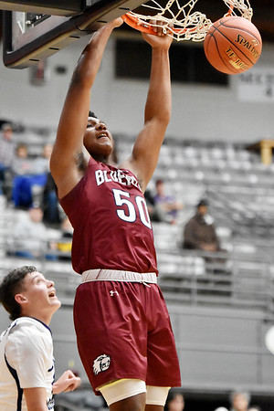 Bluefield's Sean Martin slams a dunk down during the first half of their Big Atlantic Classic basketball game against James Monroe in Beckley on Monday. (Chris Jackson/The Register-Herald)