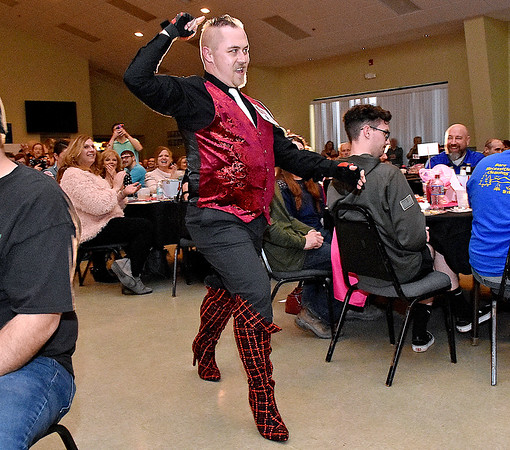 """(Brad Davis/The Register-Herald) Michael Flannery enters during the opening moments of the 2020 Hunks in Heels """"Fur"""" Real fundraising event at the Beckley Moose Lodge."""