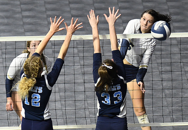 Chloe Thompson, of Shady Spring, powers a spikes against Phillips Barbour in the Class AA championship match of the girls volleyball tournament in Charleston Friday even held at the Charleston Civic Center. Shady won the Championship 3-0<br /> (Rick Barbero/The Register-Herald)