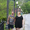Kristina Johnson, right, shares a moment with her husband Daniel Johnson, walking together on Main Street in Mt. Hope. Kristina was 18 years old when she was diagnosed as a Type 2 diabetic. Now, 13 years later, her kidneys have lost nearly all of their ability to function effectively. She is looking for a kidney donor who can help return her life to normalcy.<br /> (Rick Barbero/The Register-Herald)