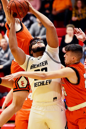 Greater Beckley Christian's Isaiah Hairston (22) is fouled going up for a layup by Summers County's (32) and (21) during their Class AA Region 3, Section 2 torunament game in Prosperity on Thursday. (Chris Jackson/The Register-Herald)