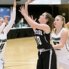 (Brad Davis/The Register-Herald) Westside's Madisyn Morgan drives to the basket as Wyoming East's Skylar Davidson, left, and Hannah Blankenship defend during Friday action at the New River Community and Technical College Shootout at the Beckley-Raleigh County Convention Center.