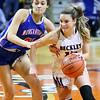 (Brad Davis/The Register-Herald) Woodrow Wilson's Cloey Frantz gets around Morgantown defender Revaya Sweeney during girls State Basketball Tournament action Wednesday afternoon in Charleston.