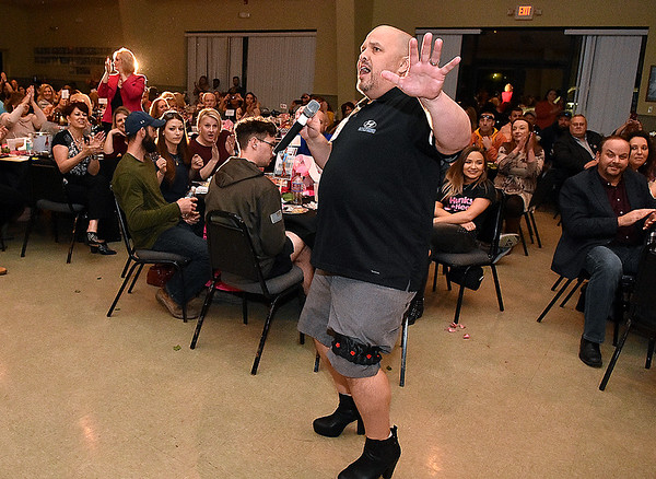 "(Brad Davis/The Register-Herald) John Musili performs during the team competition portion of the 2020 Hunks in Heels ""Fur"" Real fundraising event at the Beckley Moose Lodge."