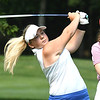 Kerri-Anne Cook, of Oceana, hits her tee shot on the par 3 third hole on the Cobb Coarse at Glade Springs during the West Virginia Junior Amateur Championship. Watching is Emma Nicol, of Charleston.<br /> (Rick Barbero/The Register-Herlad)