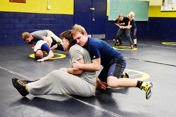 Shady Spring wrestling team members Kolby Ellis, left, and James Sellards practice at the school in Shady Spring on Wednesday. (Chris Jackso/The Register-Herald)