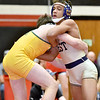 (Brad Davis/The Register-Herald) Greenbrier West's Eli White takes on Greenbrier East's Landon Hoover in the 138-pound weight class championship match at the Coalfield Conference Invitational February 8 in Coal City. East's Hoover won the match.