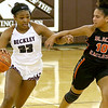 (Brad Davis/The Register-Herald) Woodrow Wilson's Victoria Staunton moves up the court as South Charleston's Myra Cuffee defends Wednesday night in Beckley.
