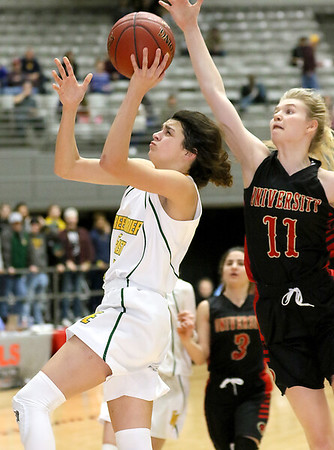 (Brad Davis/The Register-Herald) Greenbrier East's Amya Damon drives to the basket as University's Ashten Boggs defends during the final night of Big Atlantic Classic action Saturday at the Beckley-Raleigh County Convention Center.