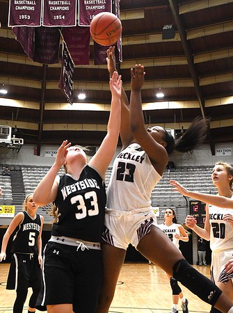 Lauren Thomas, of Westside, left, goes after a rebound against, Victora Staunton, of Woodrow Wilson, during the second annual New River CTC Invitational held at the Beckley Raleigh County Convention Center. Woodrow won 60-35.<br /> (Rick Barbero/The Register-Herald)