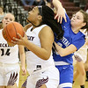 (Brad Davis/The Register-Herald) Woodrow Wilson's Jamara Walton turns to shoot in the paint as Capital's Abbie Robinson defends Wednesday night in Beckley.