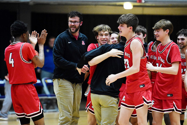 St. Albans celebrate their win over Woodrow Wilson during their Class AAA, Region 3 Conference Final Game against St. Albans in Beckley on Tuesday. (Chris Jackson/The Register-Herald)