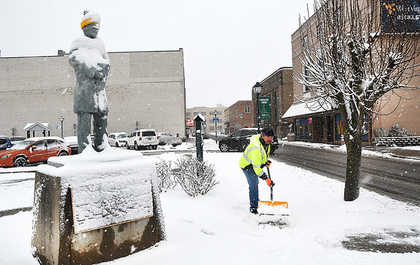 """David. """"Rockstar"""" Cook, with Beckley Board of Public Works, cleans snow off the sidewalk near Word Park off Neville Street.<br /> (Rick Barbero/The Register-Herald)"""