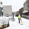"David. ""Rockstar"" Cook, with Beckley Board of Public Works, cleans snow off the sidewalk near Word Park off Neville Street.<br /> (Rick Barbero/The Register-Herald)"