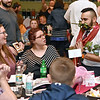 """(Brad Davis/The Register-Herald) Omar Khan, far right, mingles with the crowd 2020 Hunks in Heels """"Fur"""" Real fundraising event at the Beckley Moose Lodge."""